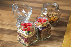 Mix of dried fruit in jars. royalty free stock photography