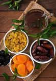 Mix dried fruits. (date palm fruits, prunes, dried apricots, raisins) and nuts, and traditional Arabic tea. Ramadan (Ramazan) food. Top view royalty free stock images