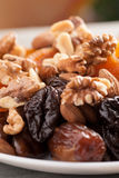 Mix of dried fruits with nuts in a white plate Stock Image