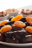 Mix of dried fruits and nuts on a wooden table Stock Photos