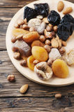 Mix of dried fruits and nuts on the wooden table Stock Images