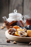 Mix of dried fruits and nuts on the wooden table Royalty Free Stock Photo