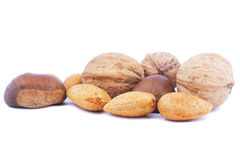 Mix Dried Nuts. Assortment Of Mix Dried Nuts. Image With Isolated Background Stock Photos