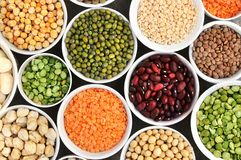 Mix of dry legume varieties: pinto and mung beans, assorted lentils, soyabean, yellow and green peas, chickpea; vegan high protein stock image