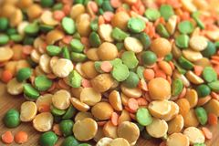 Mix of dry peas. Mix of dry green and yellow peas and lentils on wooden board. Macro stock photo