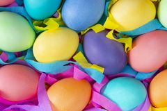Mix of Easter bright dyed chicken eggs with colorful ribbons royalty free stock images