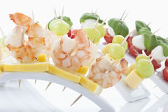 Mix of finger food in tooth picks, close up Stock Images
