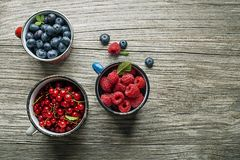 Berries fruits on wooden background stock photos