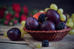 Mix of fresh berries and fruits. On rustic wooden background Royalty Free Stock Photo
