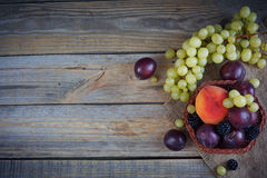 Mix of fresh berries and fruits. On rustic wooden background Royalty Free Stock Image