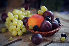 Mix of fresh berries and fruits. On rustic wooden background Stock Photos