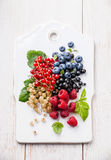 Mix of fresh berries with leaves Stock Image