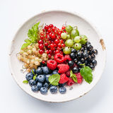 Mix of fresh berries with leaves Stock Images