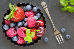 Mix of fresh berries in a small round metal backing mold and for Stock Image