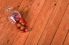 Mix fresh berries on a wooden table old. Luscious dessert close. Up. Background for advertising inscriptions Stock Photos