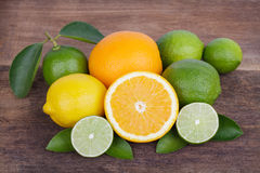 Mix of fresh citrus fruits in basket on  wood Royalty Free Stock Image