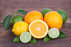 Mix of fresh citrus fruits  on wooden Royalty Free Stock Photos