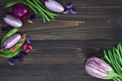 Mix of fresh farmers market vegetable from above on the old wooden board with copy space. Healthy eating background. Top view Royalty Free Stock Photos