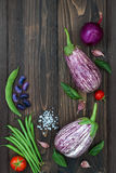 Mix of fresh farmers market vegetable from above on the old wooden board with copy space. Healthy eating background. Top view Royalty Free Stock Images