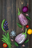 Mix of fresh farmers market vegetable from above on the old wooden board with copy space. Healthy eating background. Top view Stock Photography