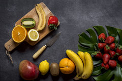 Mix of fresh fruits. On black background stock images