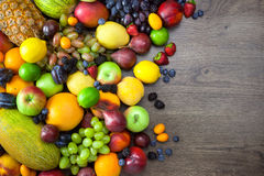 Mix of Fresh Fruits  on dark wooden table Royalty Free Stock Image