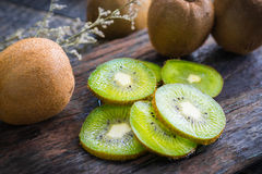 Mix of fresh fruits For good health . Kiwis , red grapes and Or. Ange on rustic wooden background . top view stock image
