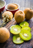 Mix of fresh fruits For good health . Kiwis , red grapes and Or. Ange on rustic wooden background . top view stock photography