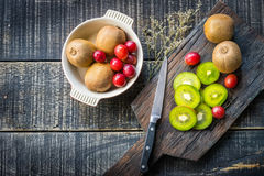 Mix of fresh fruits For good health . Kiwis , red grapes and Or. Ange on rustic wooden background . top view royalty free stock photo