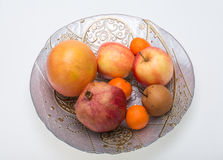Mix fresh fruits on plate Stock Images