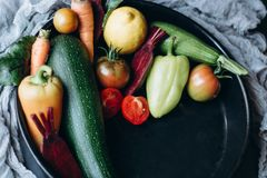 Mix of fresh fruits and vegetables on a plate. stock images
