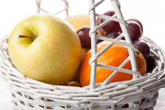 Mix of fresh fruits in the white basket Royalty Free Stock Photos