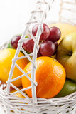 Mix of fresh fruits in the white basket Royalty Free Stock Images