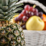 Mix of fresh fruits in the white basket Royalty Free Stock Photography