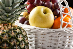 Mix of fresh fruits in the white basket Stock Photo