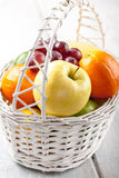 Mix of fresh fruits in the white basket Stock Images
