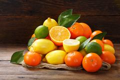 Mix of fresh fruits on wooden table royalty free stock photos