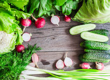 Mix fresh green vegetables on a wooden board, vegan, place for t Royalty Free Stock Photo