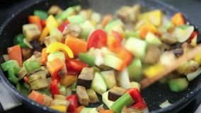 Vegan food on black pan and removing stock video footage