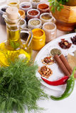 Mix of fresh herbs, spices and oil Stock Photos