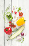 Mix of fresh spring vegetables on white planked wood background Royalty Free Stock Photos