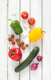 Mix of fresh spring vegetables on white planked wood background Royalty Free Stock Photo