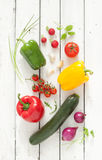 Mix of fresh spring vegetables on white planked wood background Royalty Free Stock Images