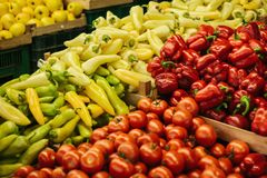 Mix of fresh tomato, peppers and paprika on the farm market. Natural local products on the farm market. Harvest. Seasonal products. Food. Vegetables Royalty Free Stock Photos