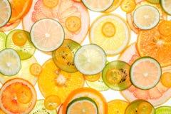 Mix of fresh transparent citrus fruits on white. Luminous background Royalty Free Stock Photo