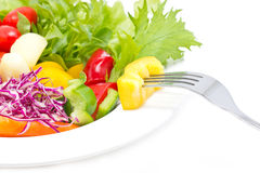 Mix Fresh Vegetables With Fork In Plate. Stock Images