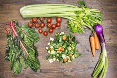 A mix of fresh vegetables on an old table ready to be cooked to Stock Photography