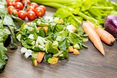 A mix of fresh vegetables on an old table ready to be cooked to Stock Image