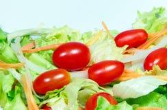 Mix fresh vegetables. Mix fresh vegetable,carrot,on ion,tomato,lettuce on white background Royalty Free Stock Photo