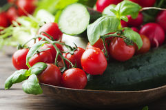 Mix of fresh vegetables on the wooden table. Selective focus Royalty Free Stock Photo